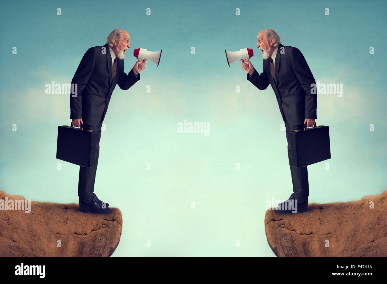 senior businessmen shouting through megaphones business conflict concept - Stock Image
