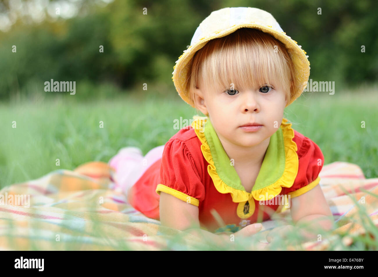 girl child 2 years blonde small one park gardens nature summer day elegant  dress panama hat