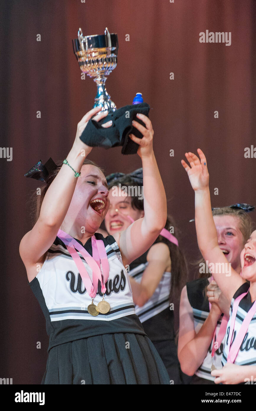 North West London junior cheer leading competition 2014 the winners Wolves celebrate with cup trophy - Stock Image