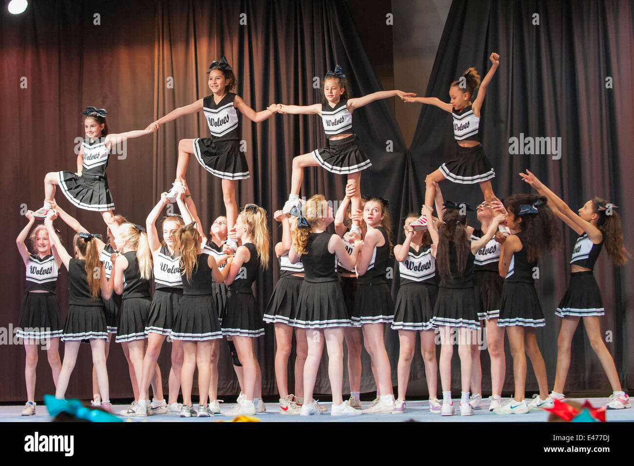 North West London junior cheer leading competition 2014 The Wolves winning team in acrobatic formation - Stock Image