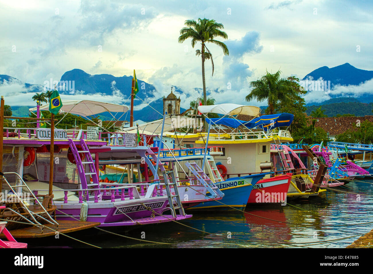 Parati, Rio de Janeiro, Brazil. Colorful ships at the Parati´s port. More commonly use for seightseeing tours - Stock Image