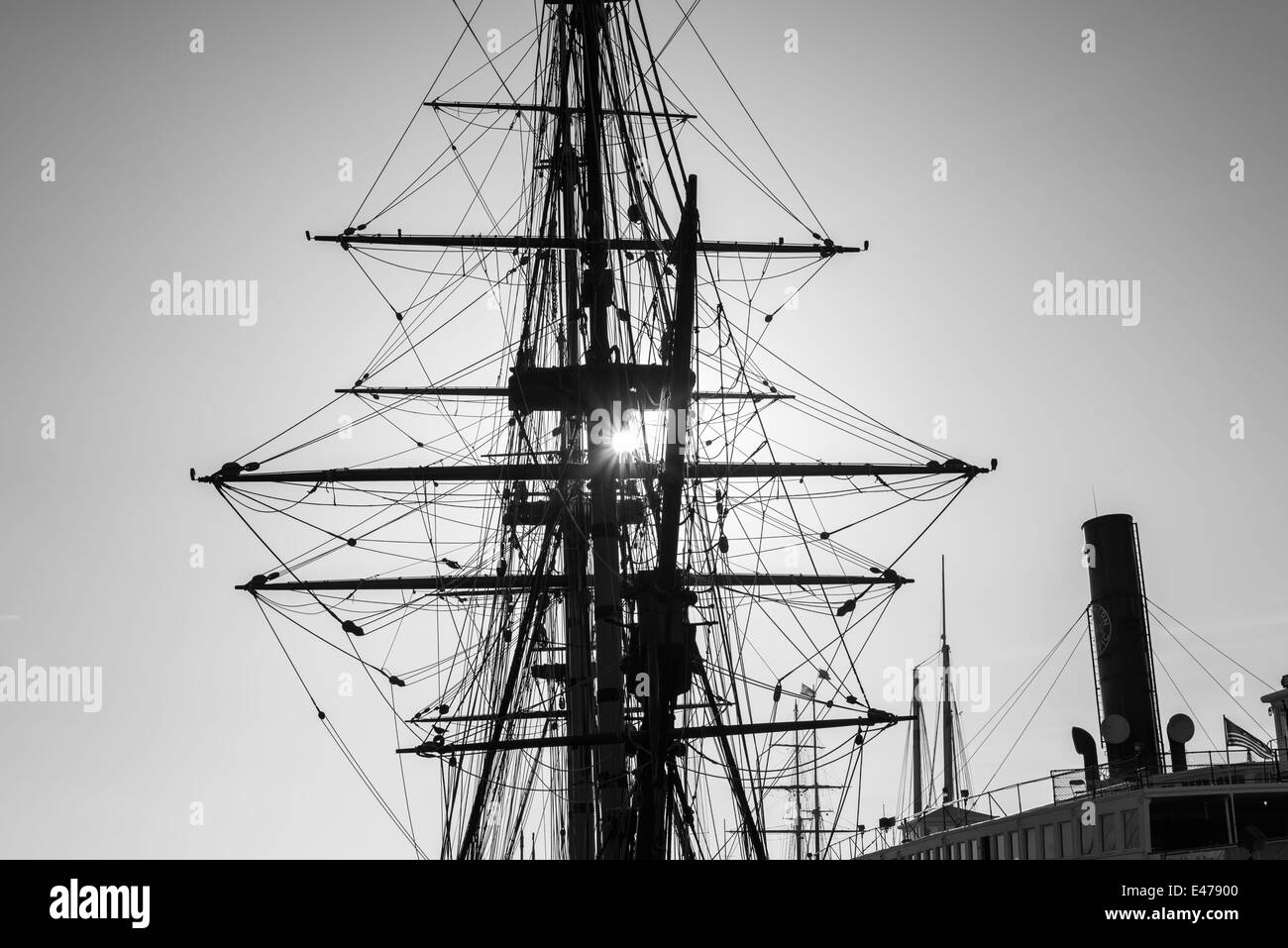 A ship's mast and rigging against the setting Sun. San Diego, California, United States. - Stock Image