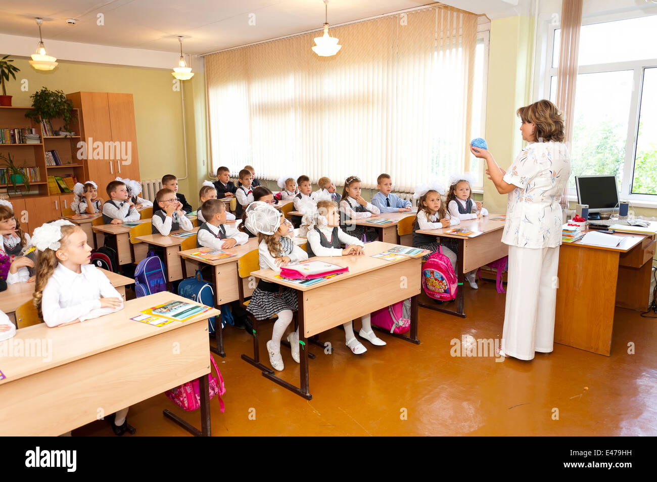 Elementary Classroom Pictures ~ Elementary school students at classroom desks and their