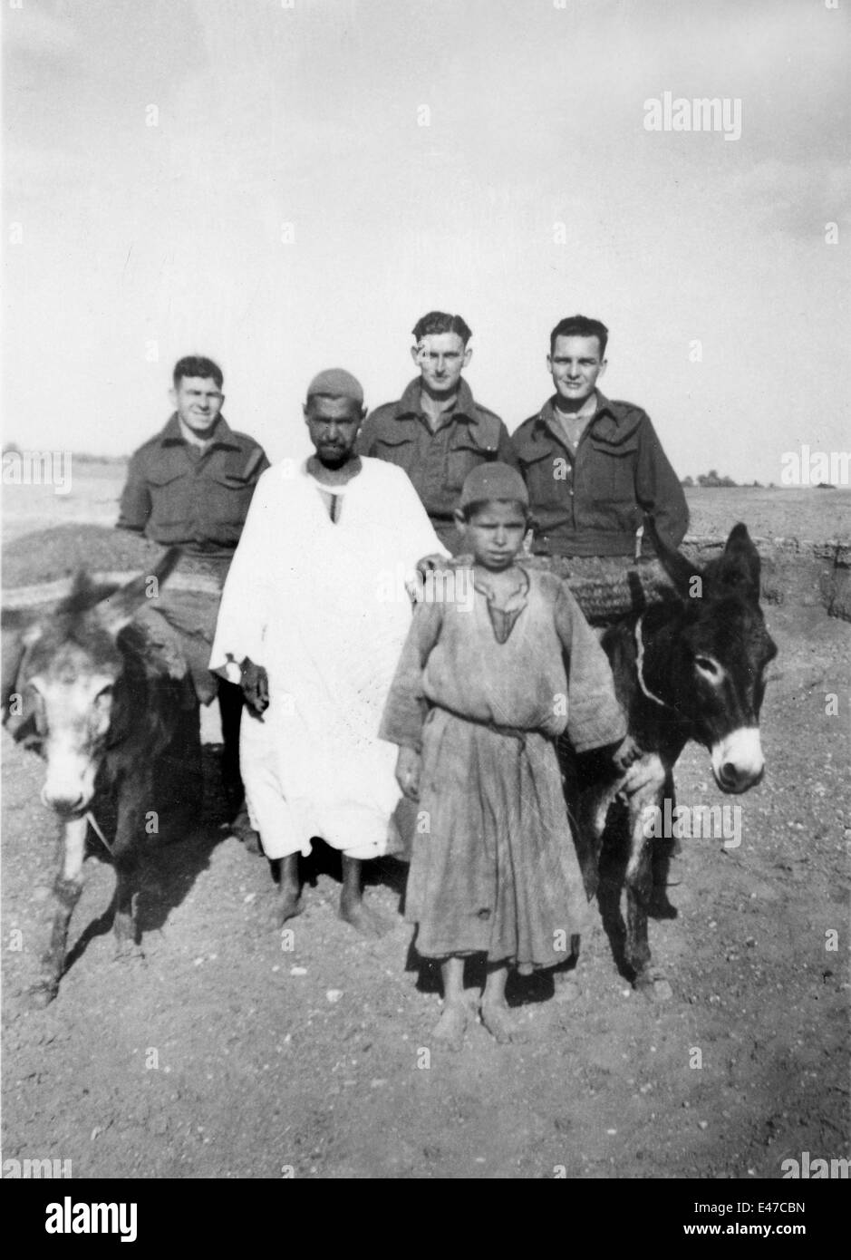 British REME soldiers with locals father and son with donkeys at Tel-el-Kebir Egypt 1943 World War Two 2 - Stock Image