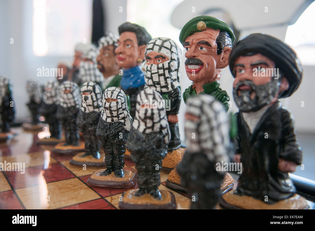 Middle East political leaders with Jihadists as part of an American anti-terrorist themed chess set - Stock Image