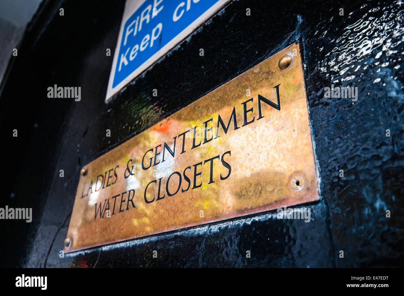 Brass sign for Ladies and Gentlemen Water Closets - Stock Image