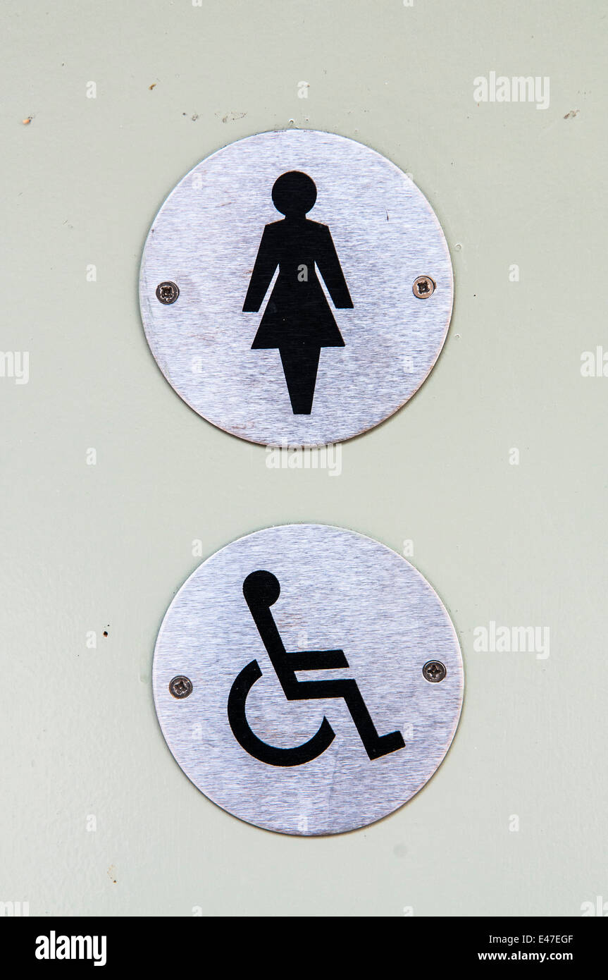 Signs for a ladies and disabled toilet on a door - Stock Image