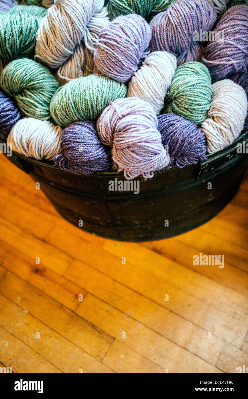 Wicker basket of  yarn wool skeins - Stock Image