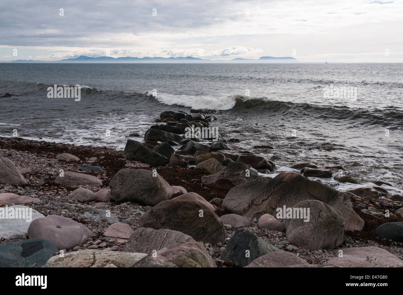 Looking at the Isle of Skye from Melvaig shore on a cloudy day across The Minch, Scotland Stock Photo