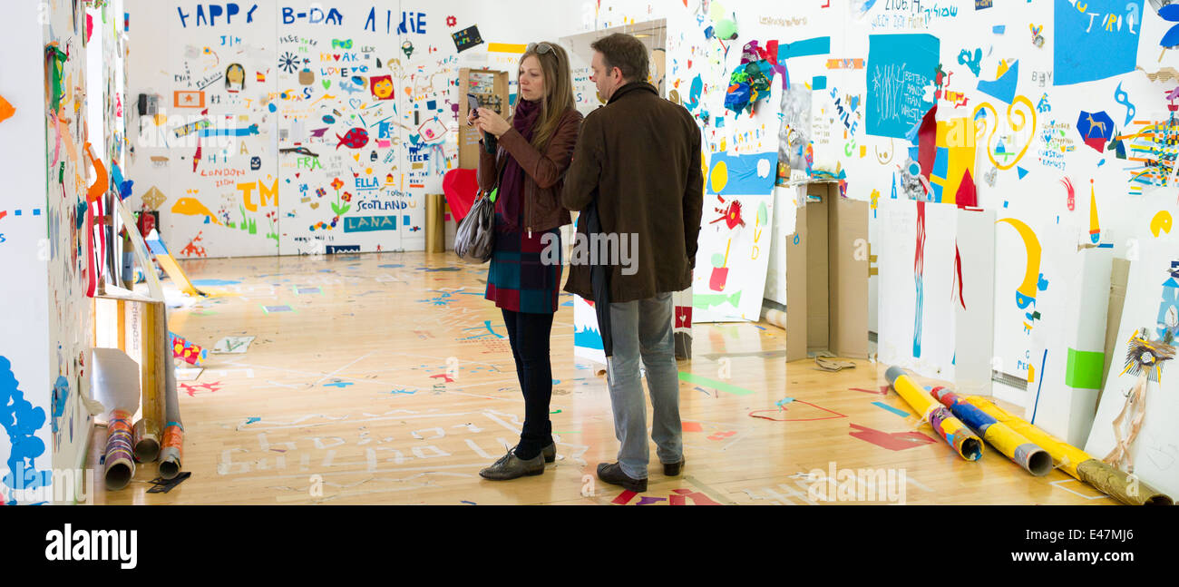 Tourists at Atelier Public 2, exhibition of artwork by members of the public in Gallery of Modern Art, GoMA, Glasgow,SCOTLAND - Stock Image