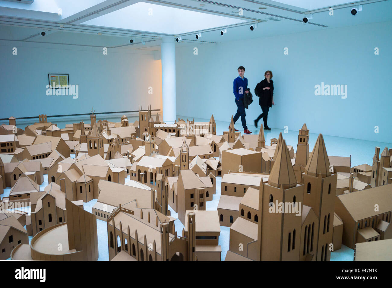 Tourists view 'Generation - 286 Places of Worship in Edinburgh' by Nathan Coley, in Gallery of Modern Art - Stock Image