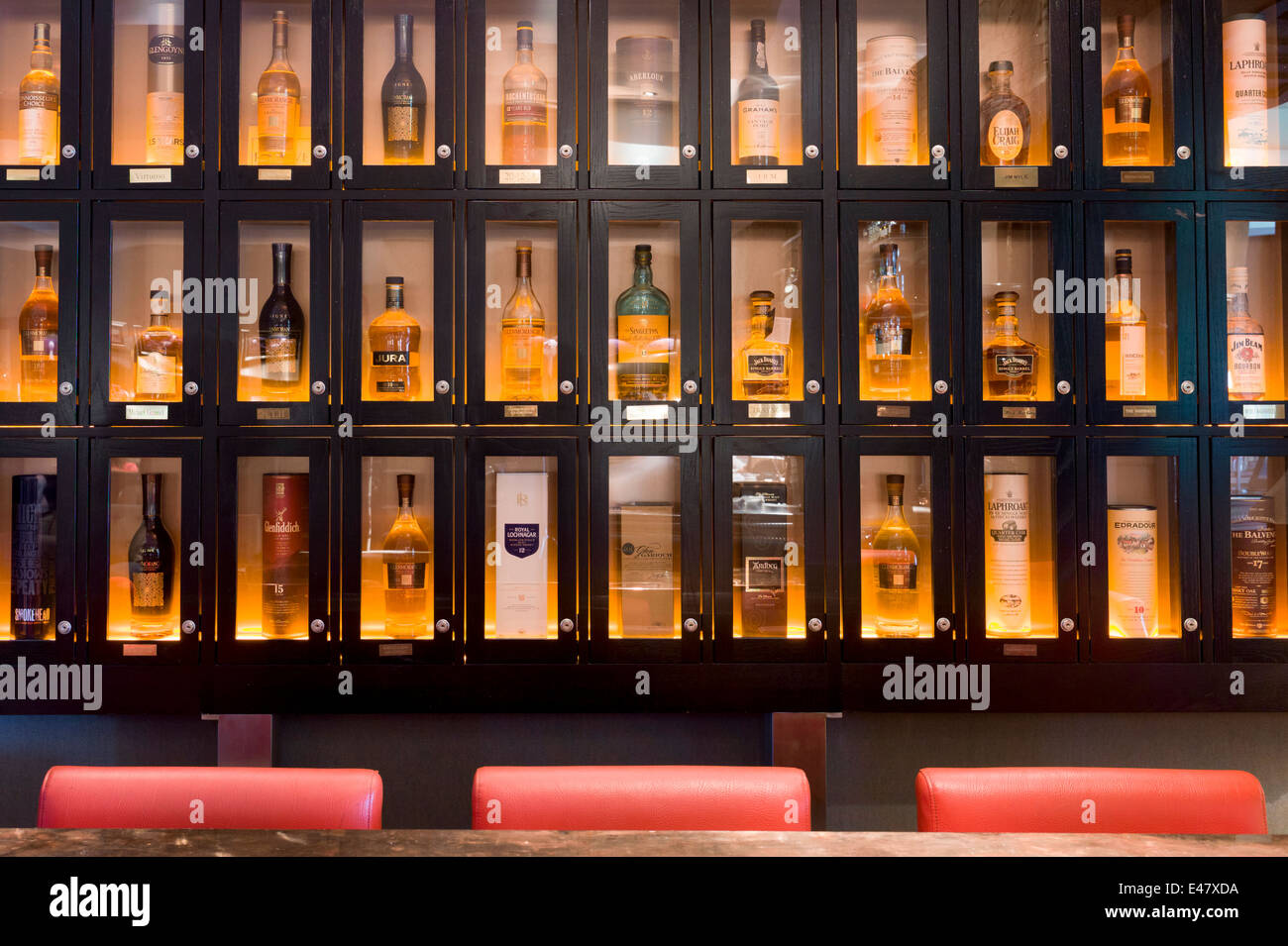 Whisky lockers for privileged clients in the Great Scots Bar at Cameron House Hotel on Loch Lomond near Glasgow, - Stock Image