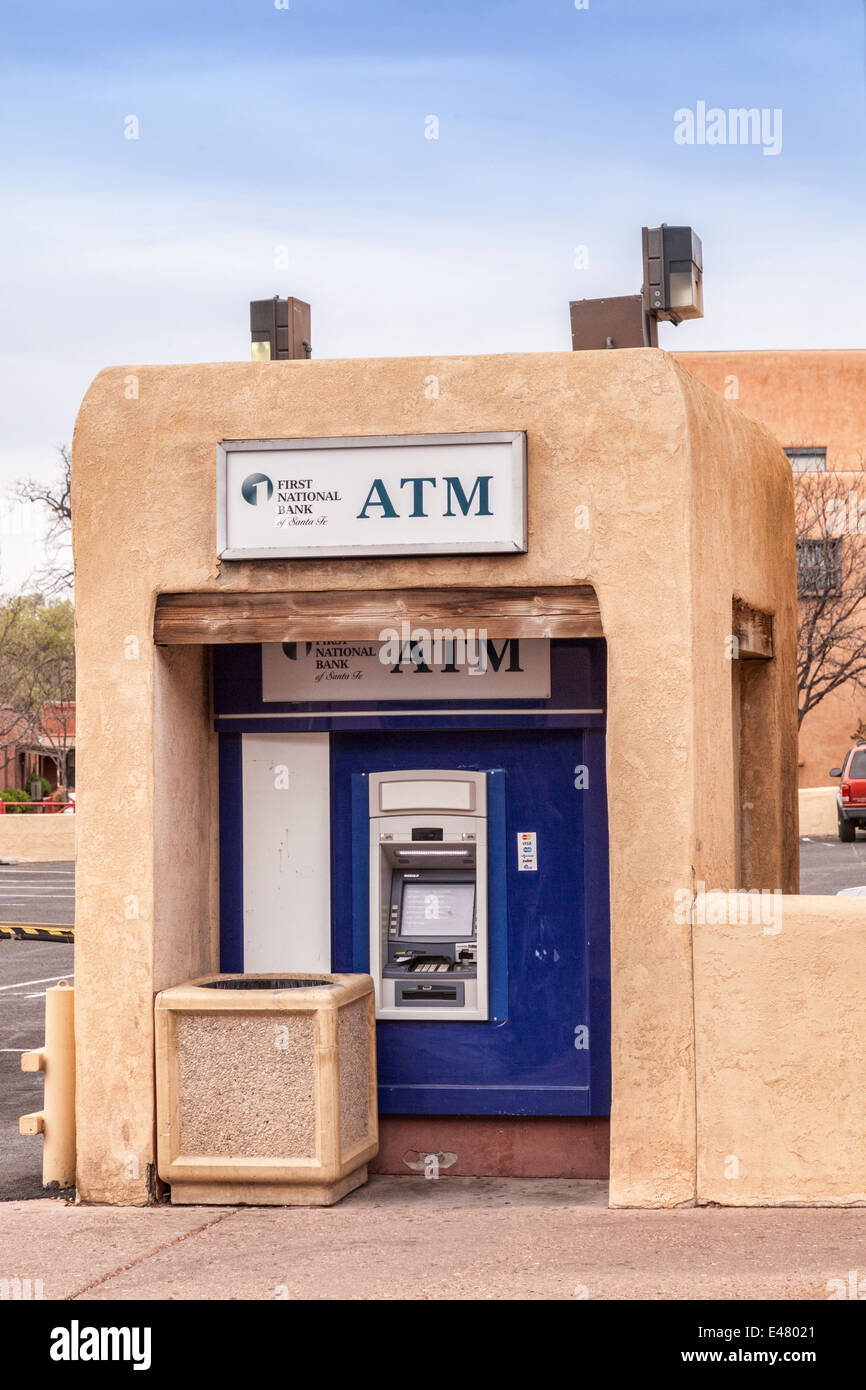 ATM in traditional style adobe housing in the historic district of Santa Fe, New Mexico. - Stock Image