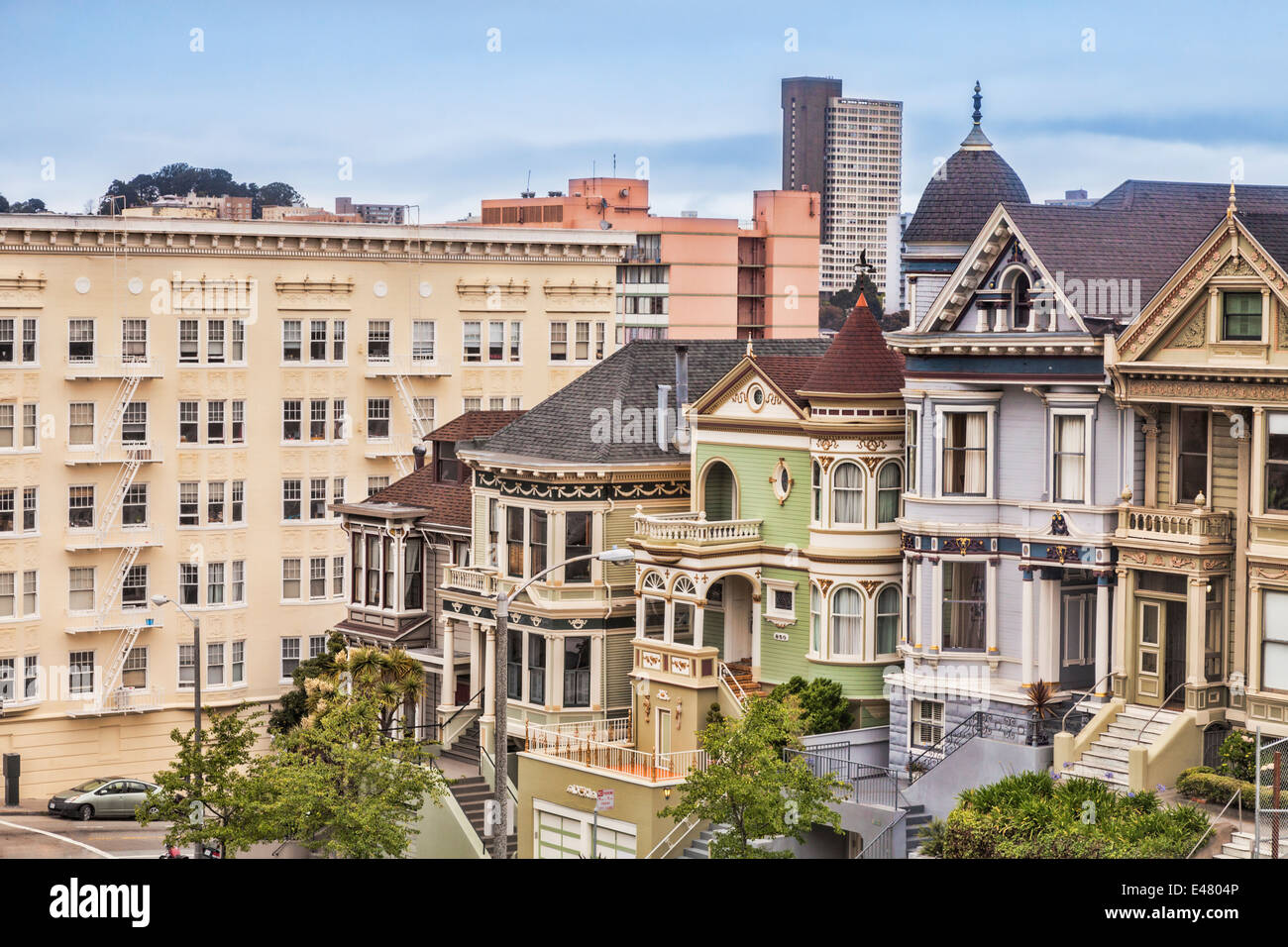 Beautiful old houses in Alamo Square, San Francisco, known as the Painted Ladies. They are an icon of the city. - Stock Image
