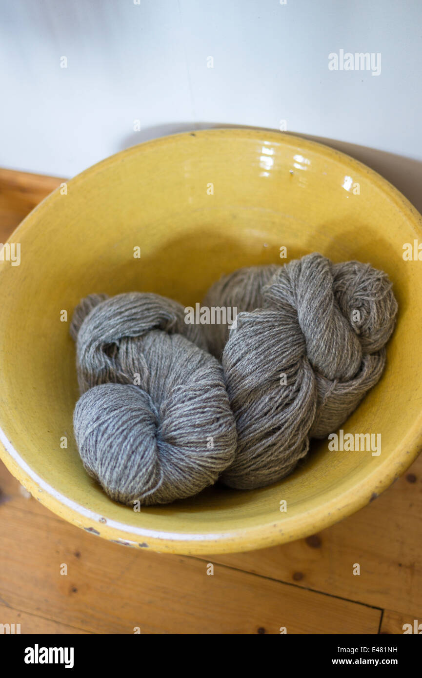 Skeins of local wool - Lambswool - from grey Gotland sheep at Croft Wools and Weavers, Applecross in the Highlands - Stock Image