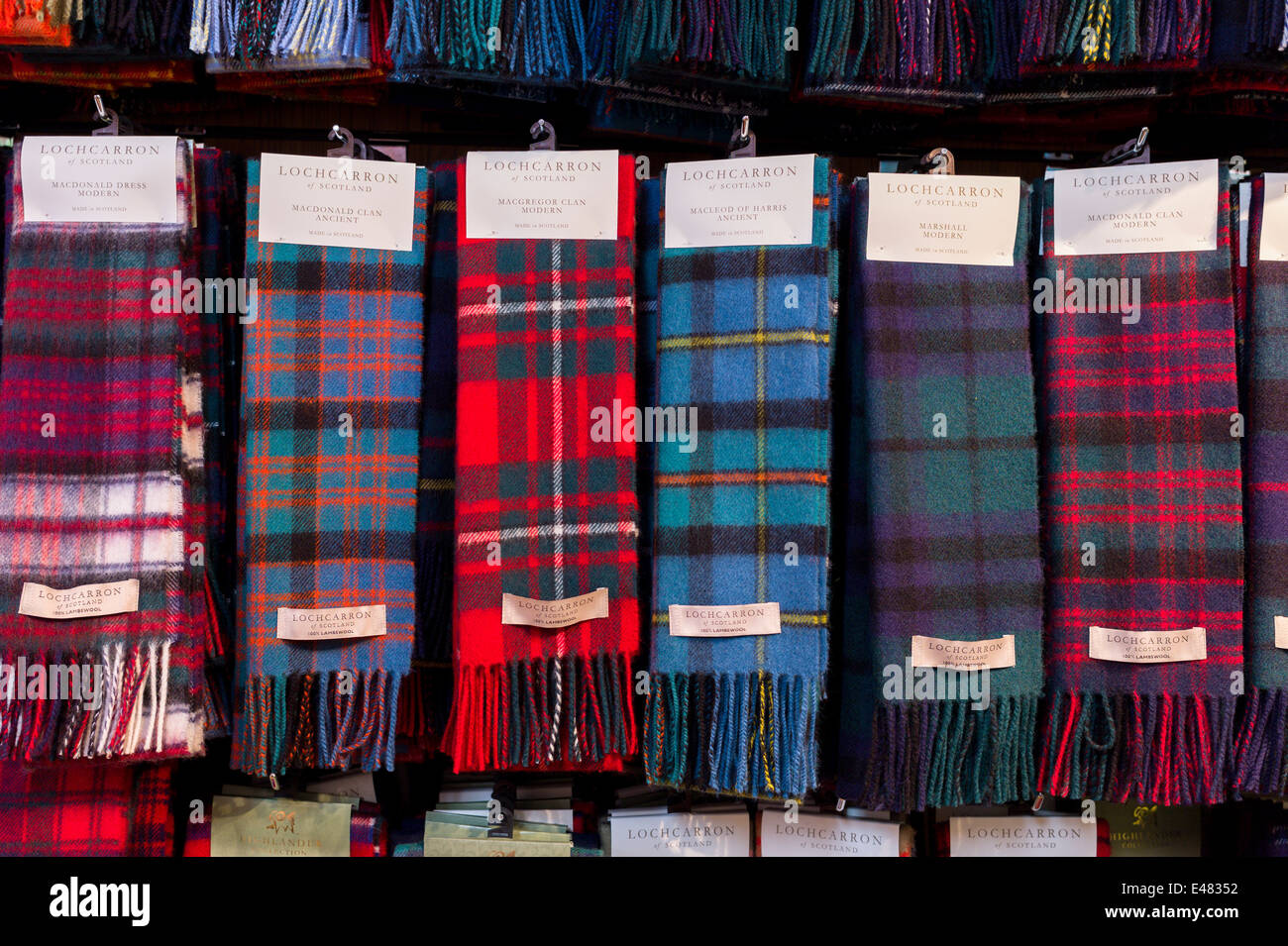 Traditional highland clan tartan scarves on display for sale at Lochcarron Weavers in Lochcarron in the Highlands - Stock Image