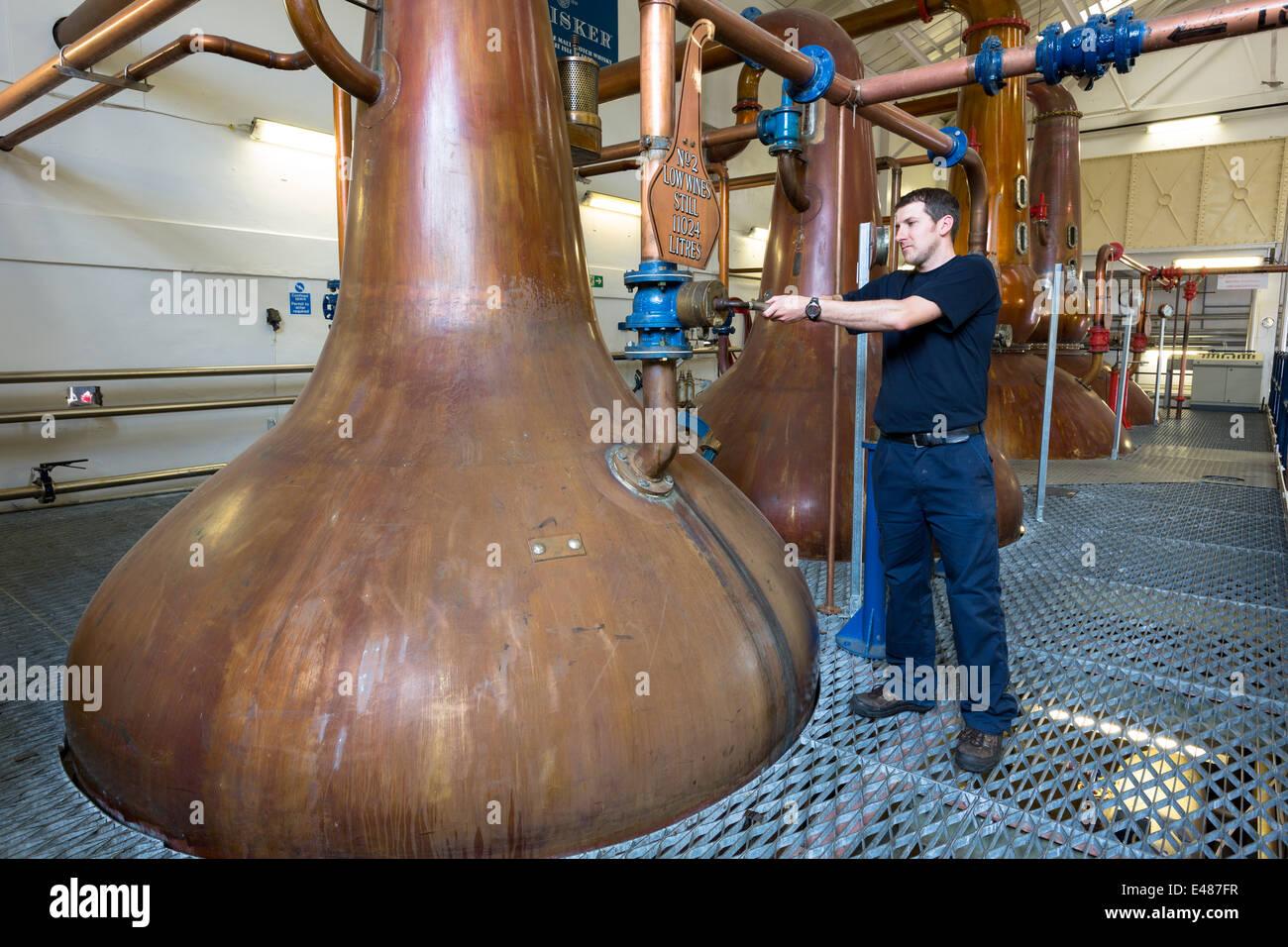 Stillsman and copper spirit stills in Stillshouse at Talisker Whisky Distillery makes single malt in Isle of Skye, - Stock Image
