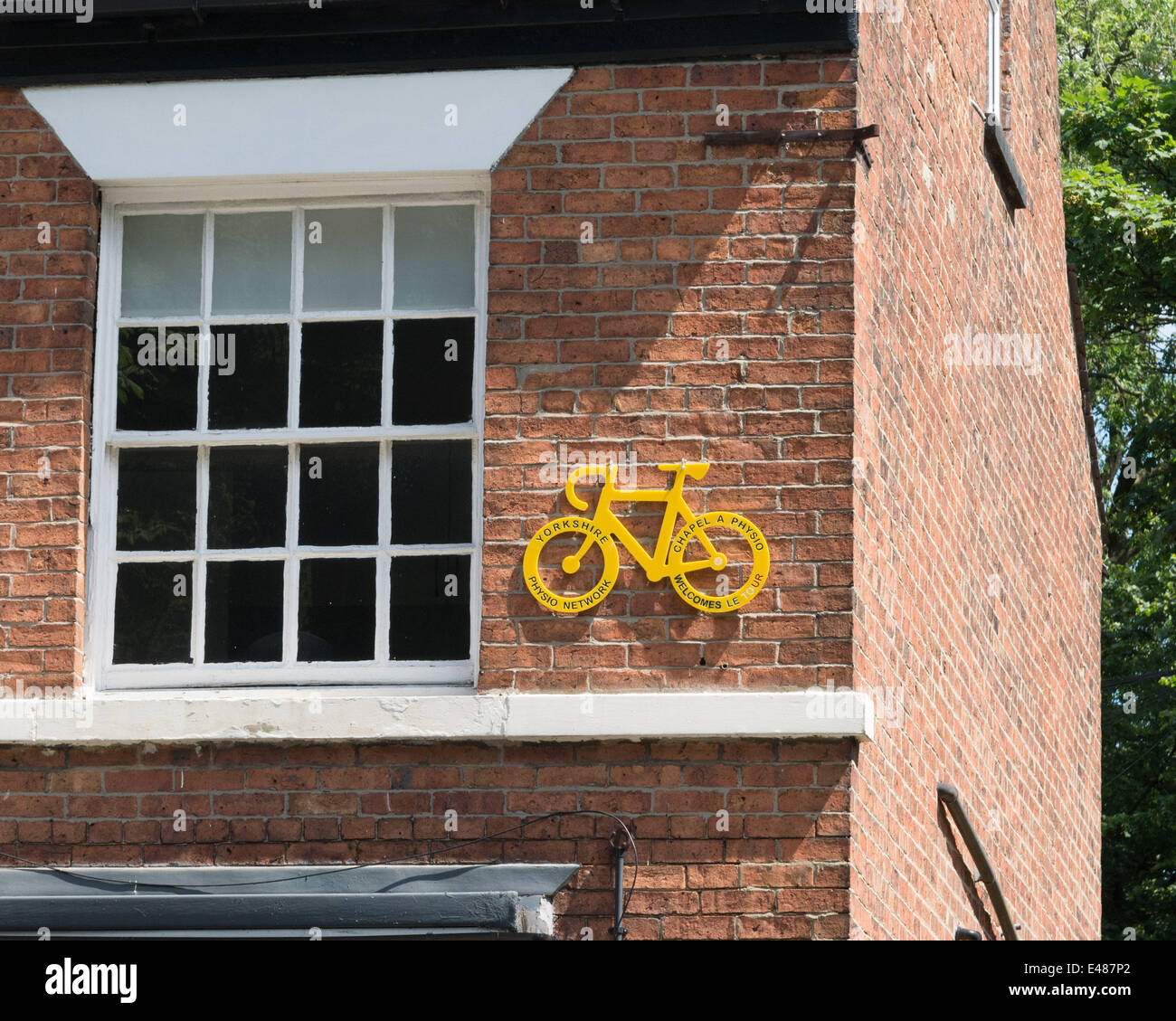 Chapel Allerton, Leeds, UK. July 5th 2014.  Local businesses decorate to celebrate the Tour De France, which is - Stock Image