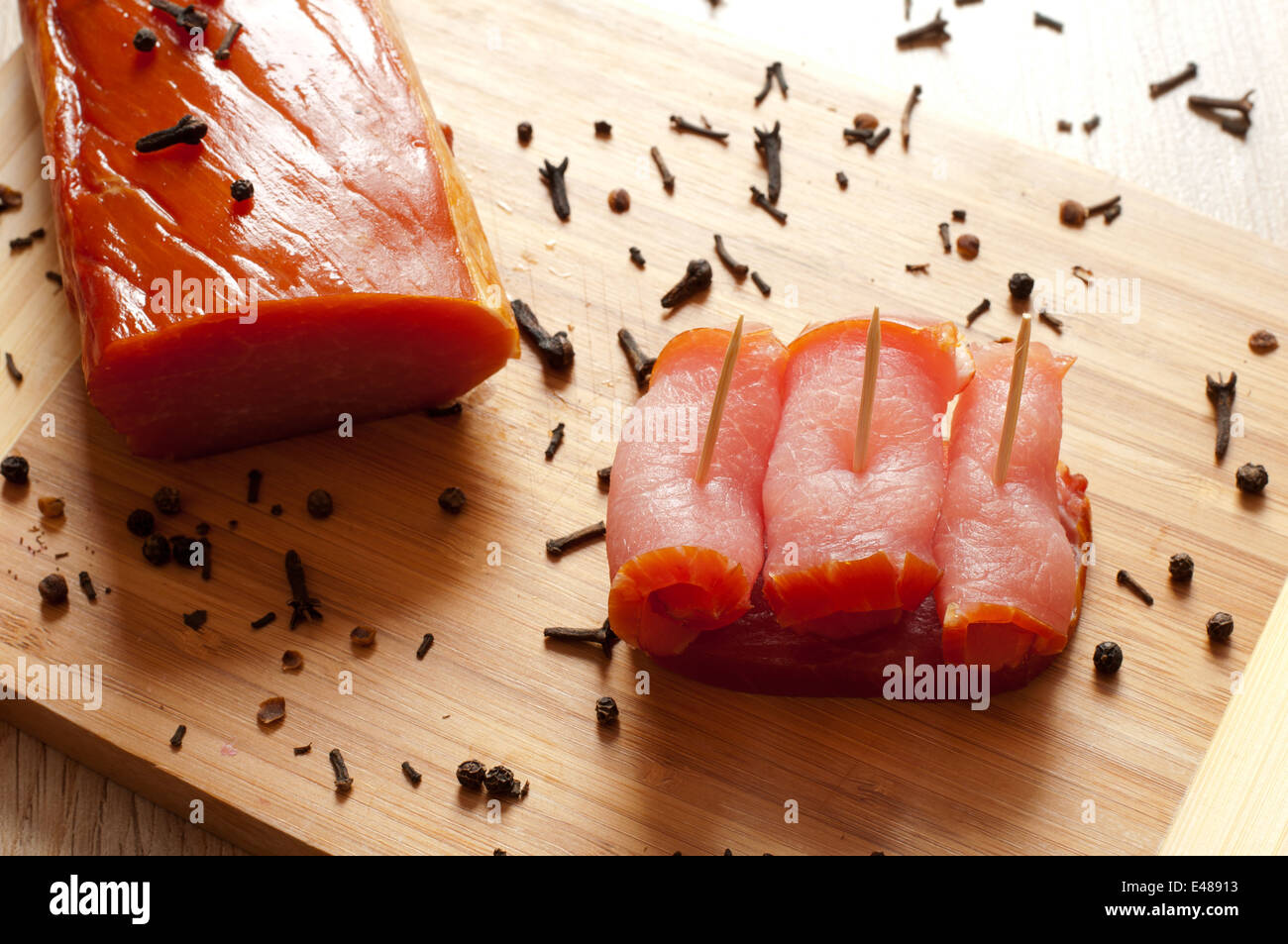 bacon pork smoked meat ready dish eating food piece slice sliced smoked canapes toothpicks appetizing tasty nobody - Stock Image