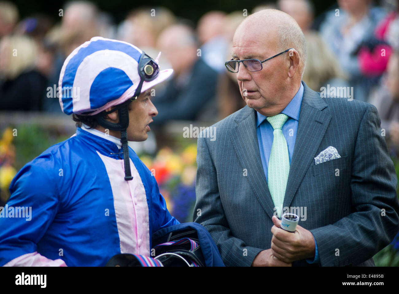 Jockey Silvestre De Sousa talks to owner Newmarket Racecourse - Stock Image