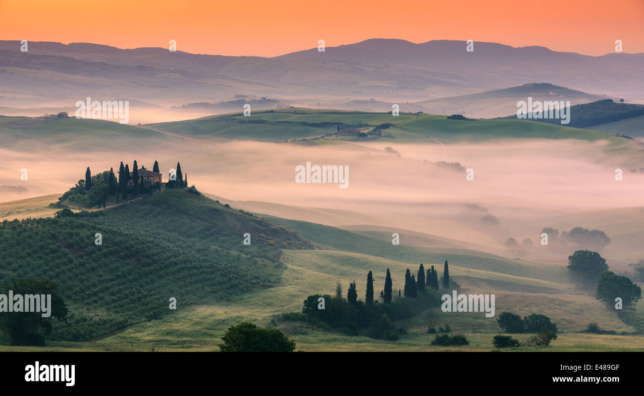 Famous Podere Belvedere in morning light, in the heart of the Tuscany, near San Quirico in de Val d'Orcia valley Stock Photo