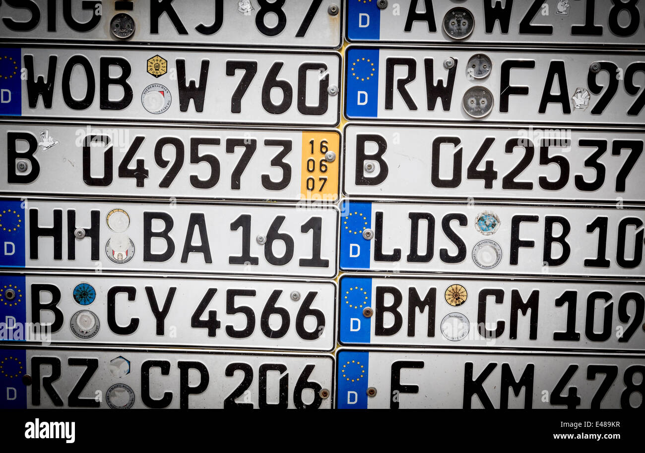 old german number plates on a wall, with vignette Stock Photo ...