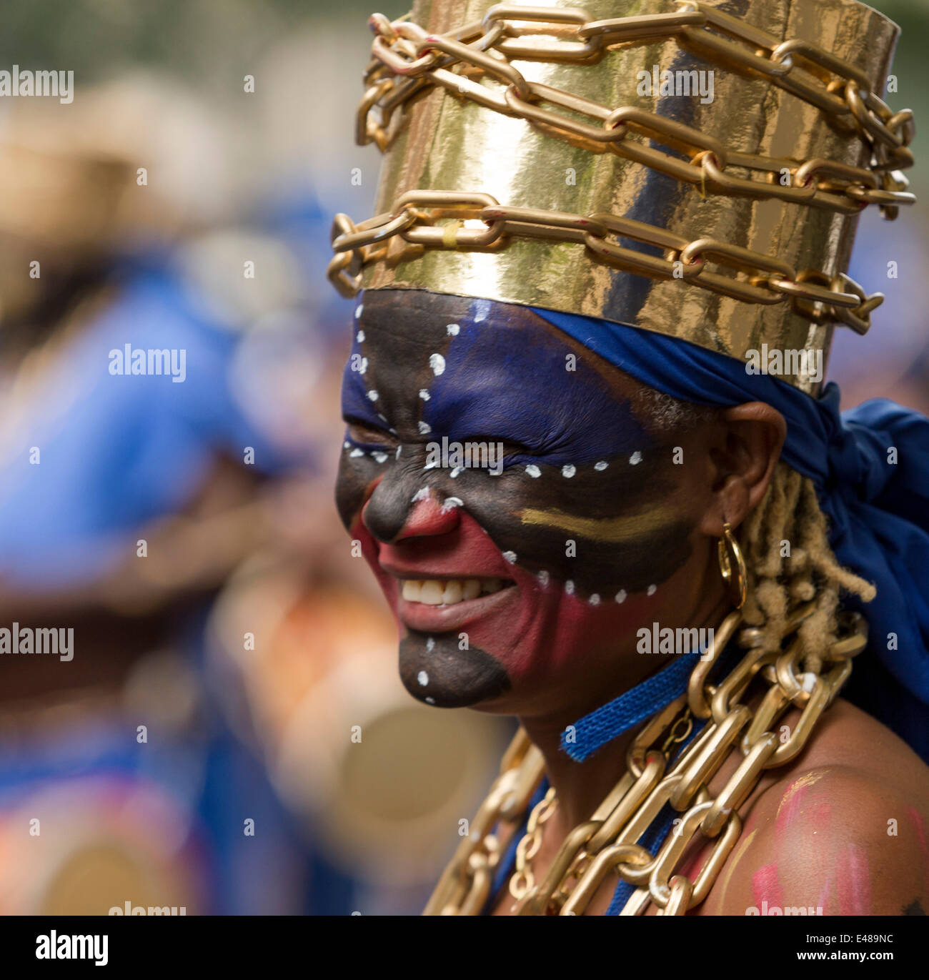 Paris, France. July 5th 2014. Participant of the parade smiling at her friends during the parade. For the 13th year - Stock Image
