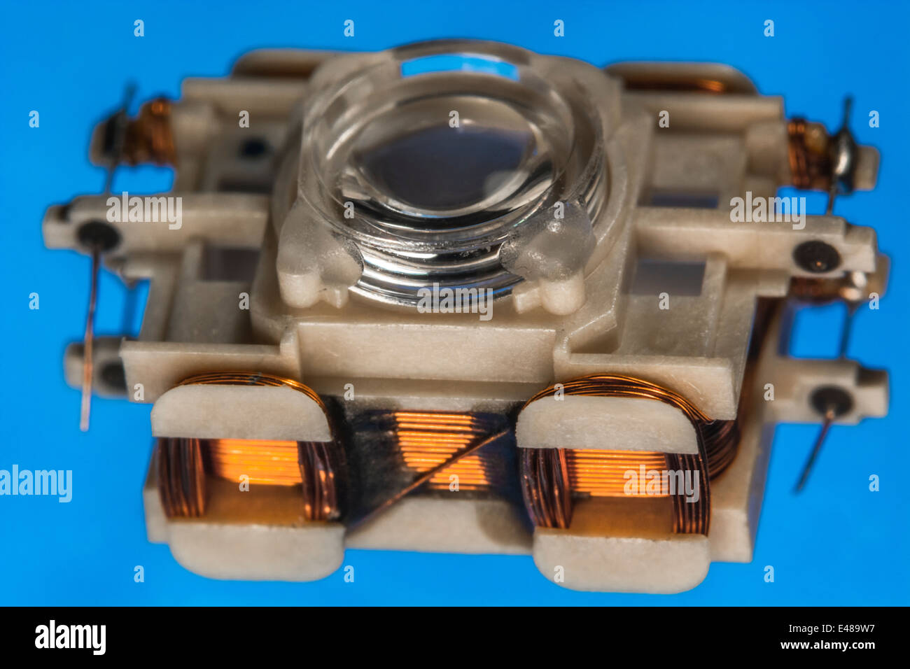 Macro-photo of laser focusing head from CDROM / DVD drive. See 'Description' for focus details. - Stock Image