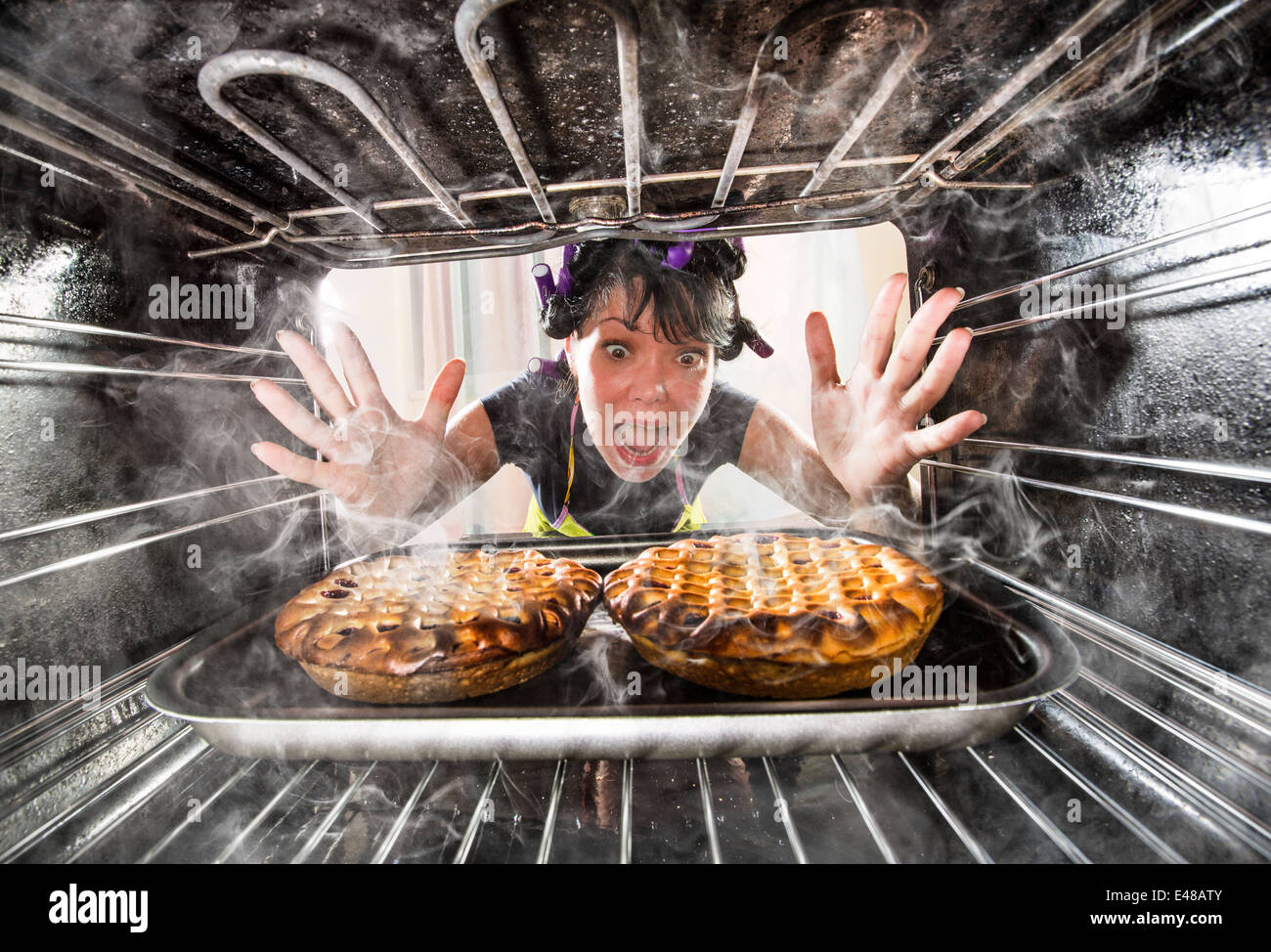 Housewife preparing cakes in the oven at home, view from the inside of the oven. Cooking in the oven. - Stock Image