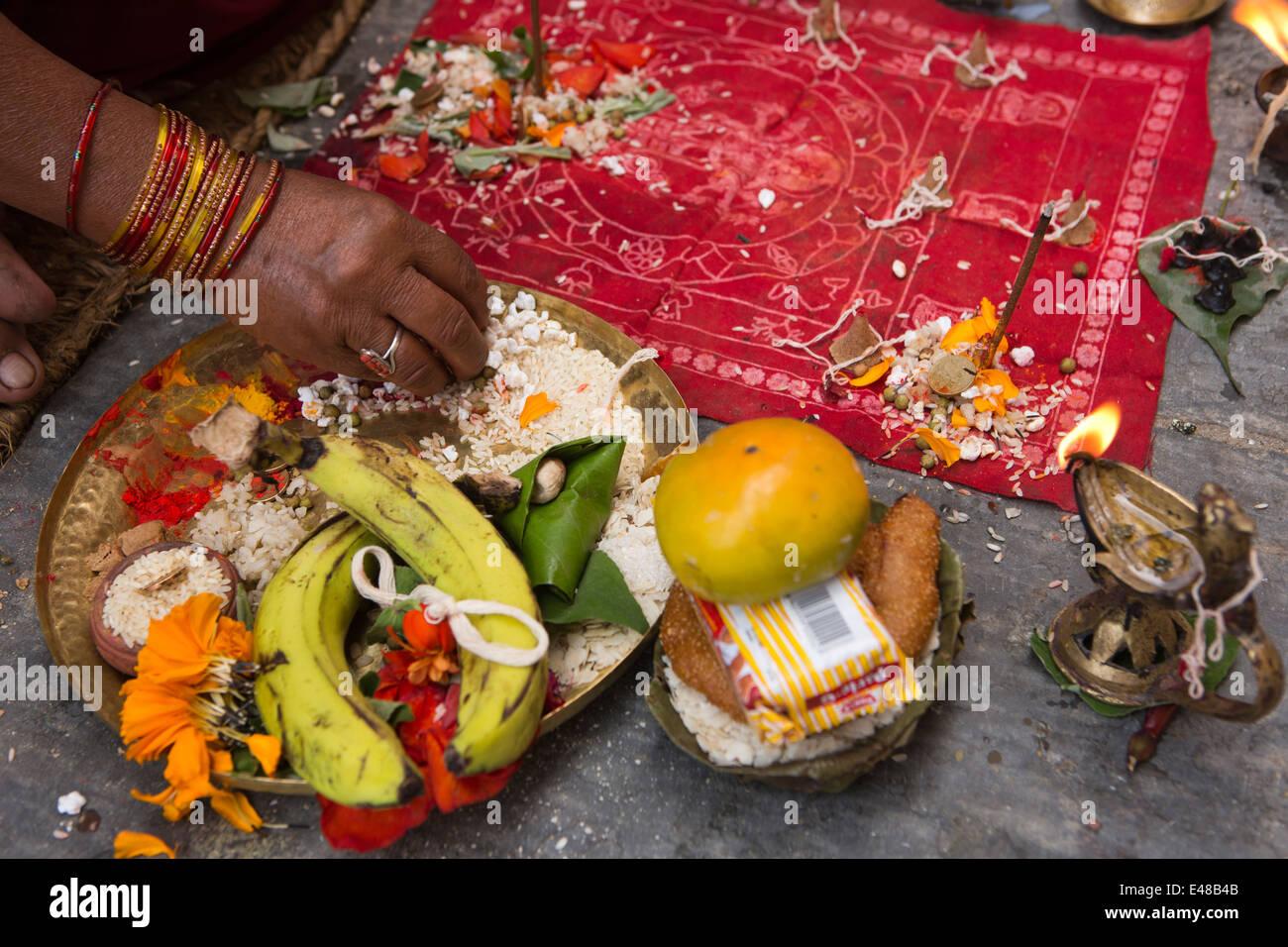 Nepal, Kathmandu, Nag Bahal, Kathesimbhu Stupa food and domestic items used in ritual Buddhist puja - Stock Image