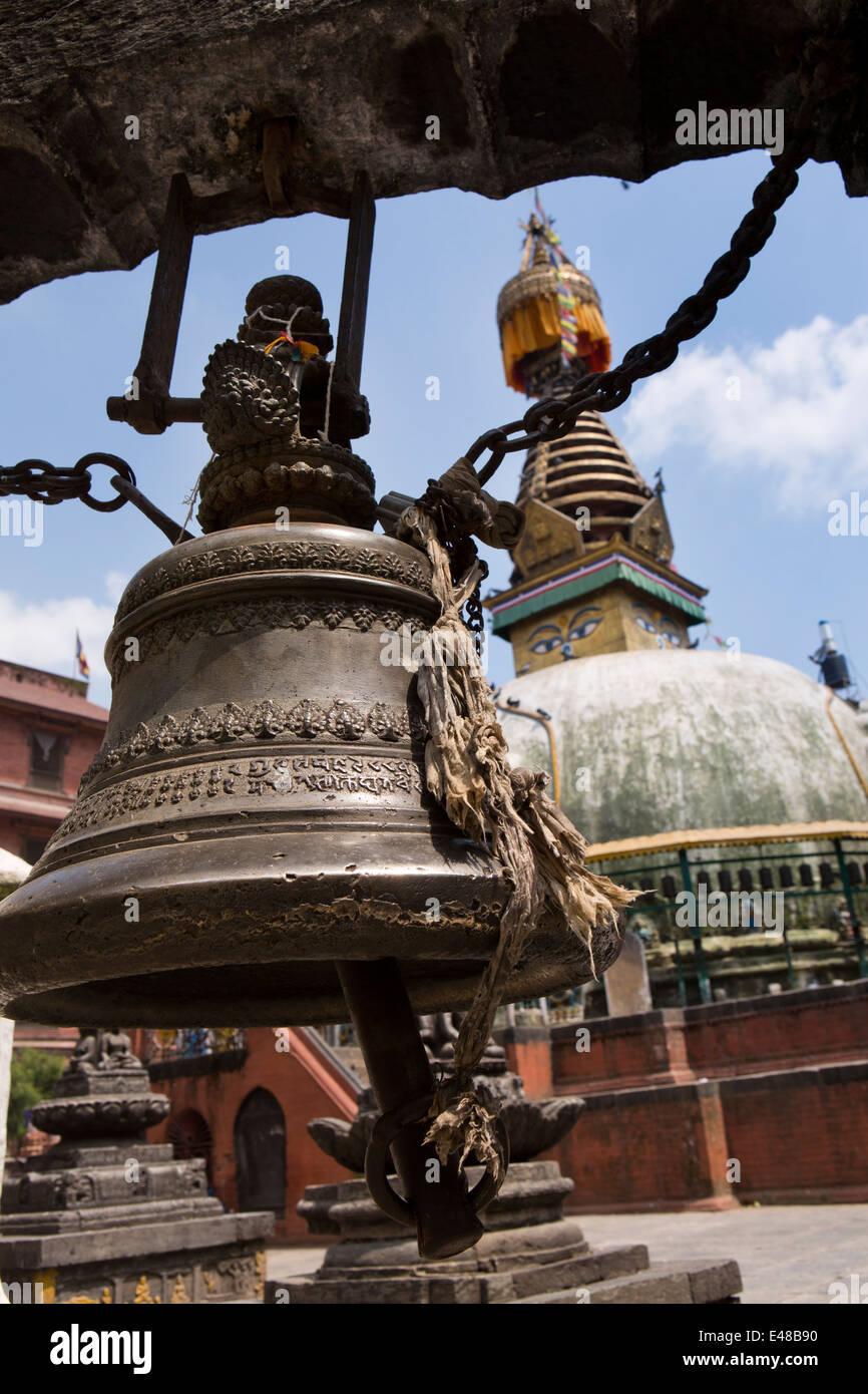 Nepal, Kathmandu, Kathesimbhu Stupa, Brass Temple Bell decorated with text in Nepali script - Stock Image