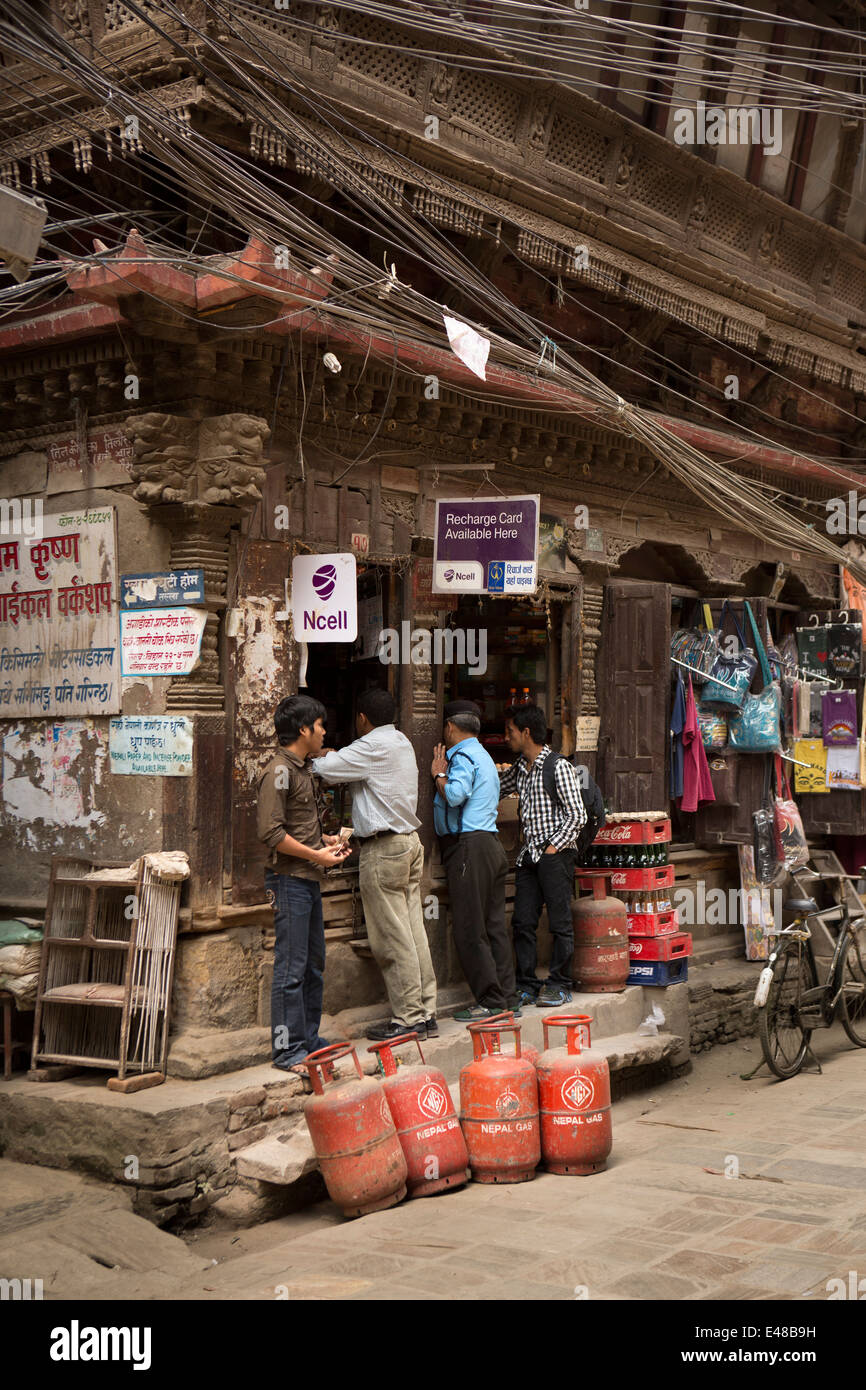 Nepal, Kathmandu, Chandraman Singh Marg, shop in small old carved wooden house - Stock Image