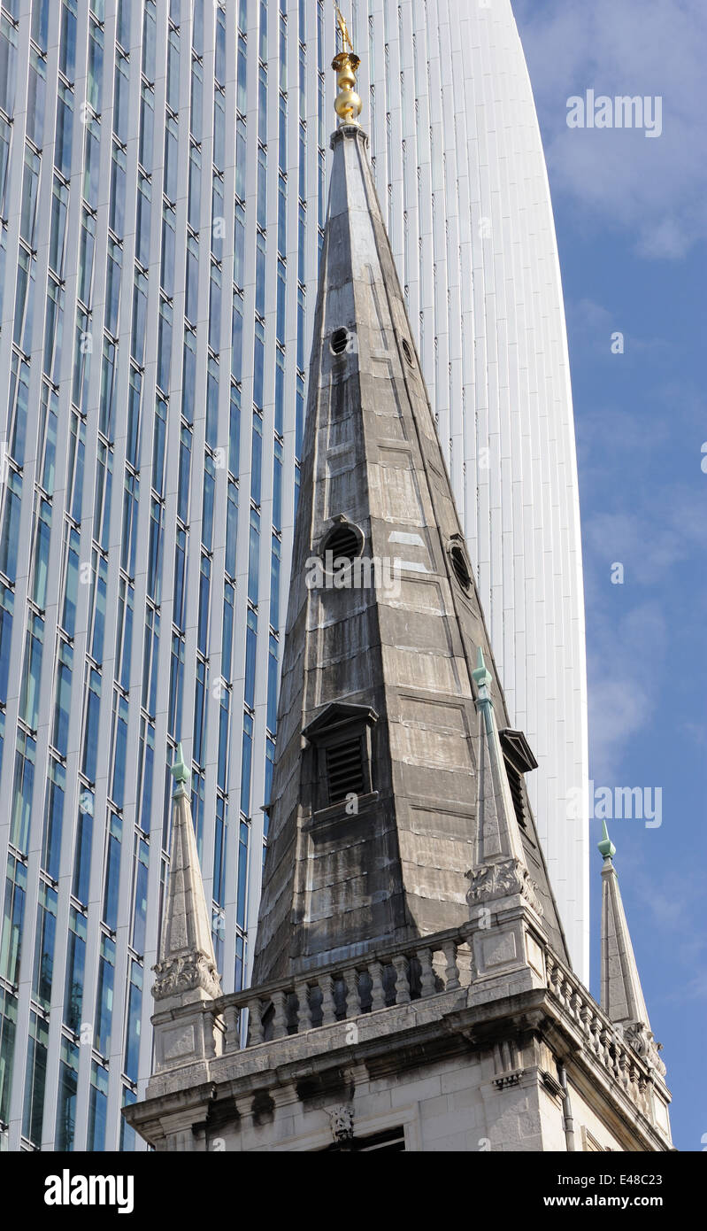 The tower and spire of St Margaret Pattens on Eastcheap against modern office buildings. Eastcheap, City of London, - Stock Image