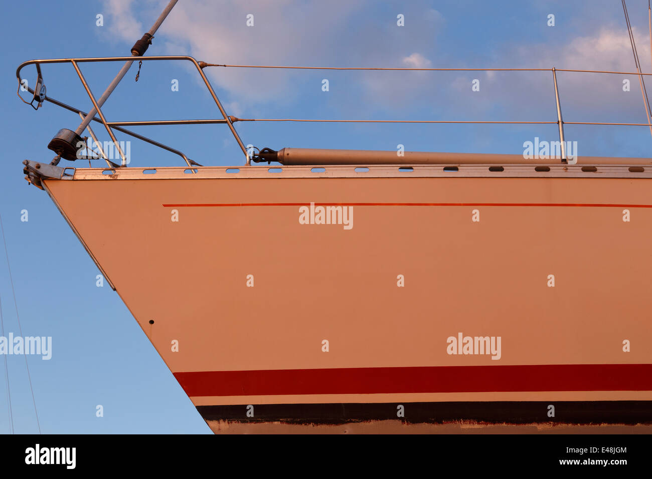 Yacht out of water, just been repainted orange. Stock Photo