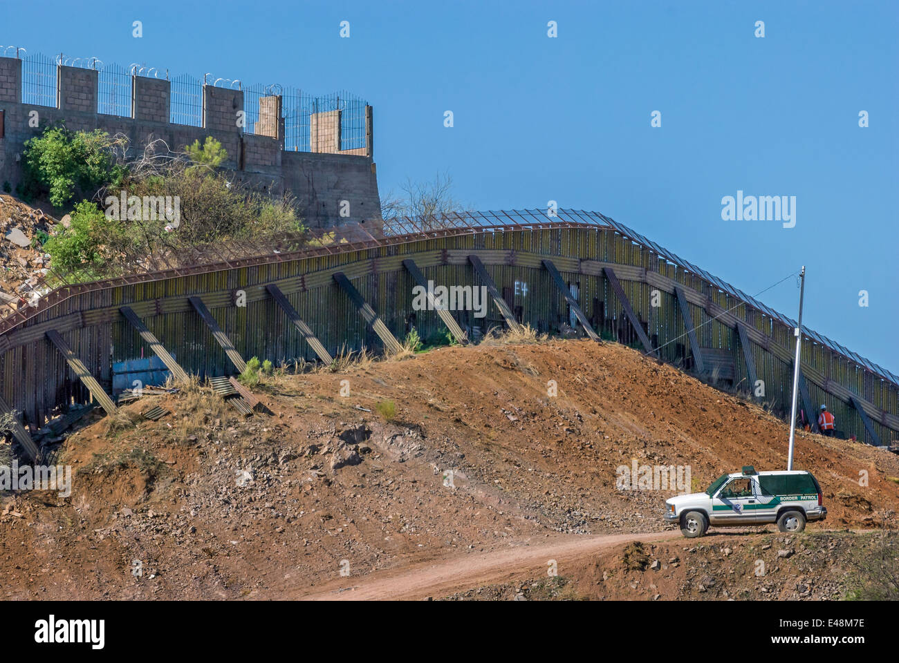 US border fence near downtown Nogales Arizona USA, looking south into Nogales Sonora Mexico - Stock Image