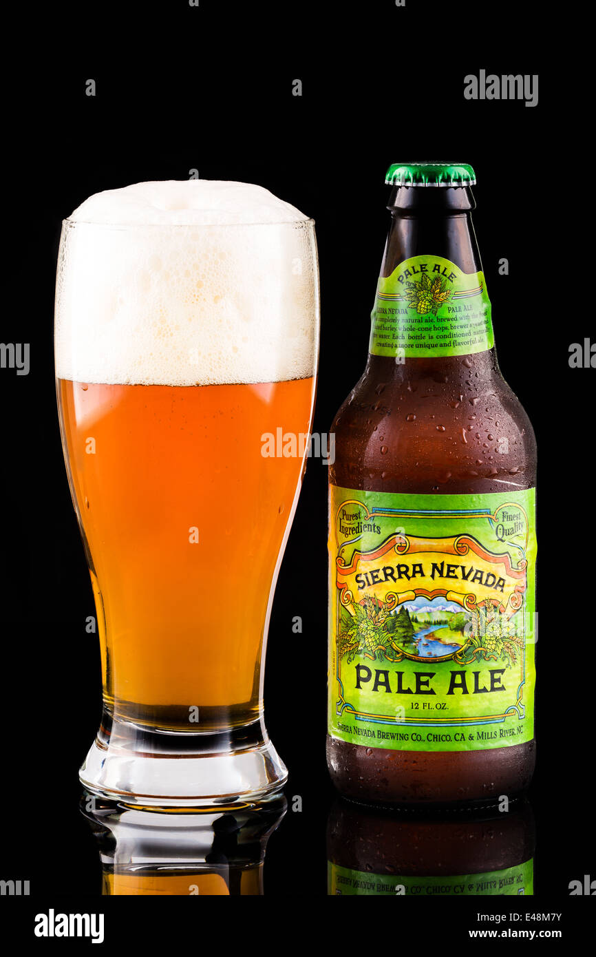 Sierra Nevada beer bottle and glass. Sierra Nevada's Pale Ale is the second best-selling craft beer in the United - Stock Image