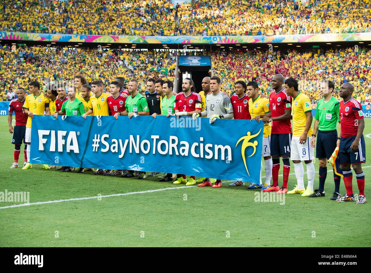 Two team group line-up, JULY 4, 2014 - Football / Soccer : Players and referees gather behind a banner against racism - Stock Image