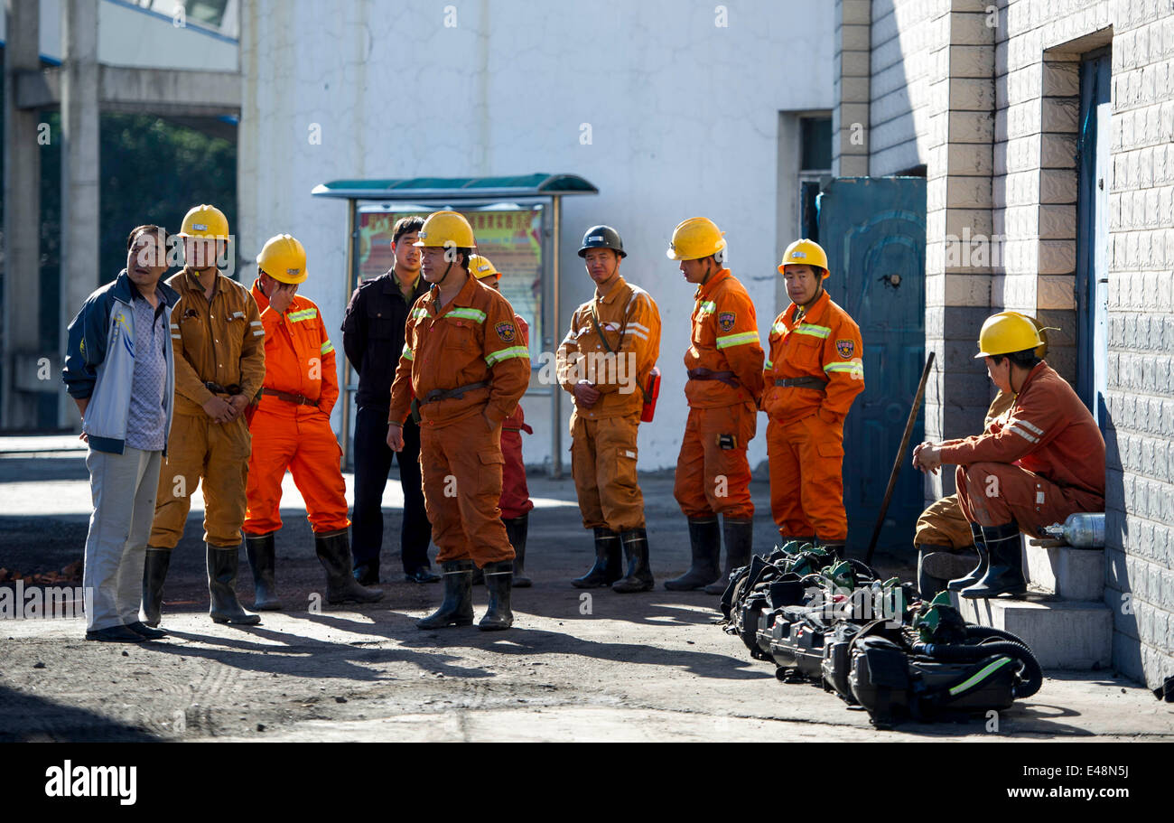 Fukang, China, 6th July, 2014.  Rescuers wait to enter the pit where a gas blast traps 17 miners at the No. 1 coal Stock Photo
