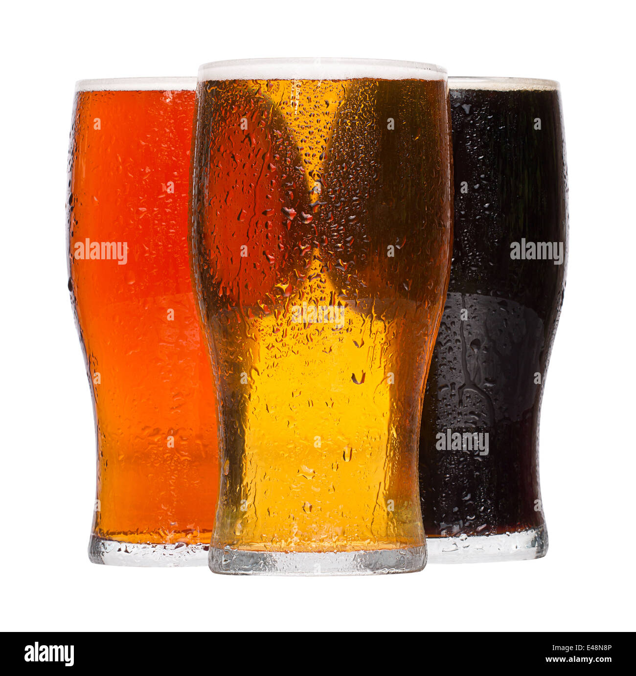 Different chilled refreshing pints of Beer, lager and stout served by the Alcoholic drinks industry - Stock Image