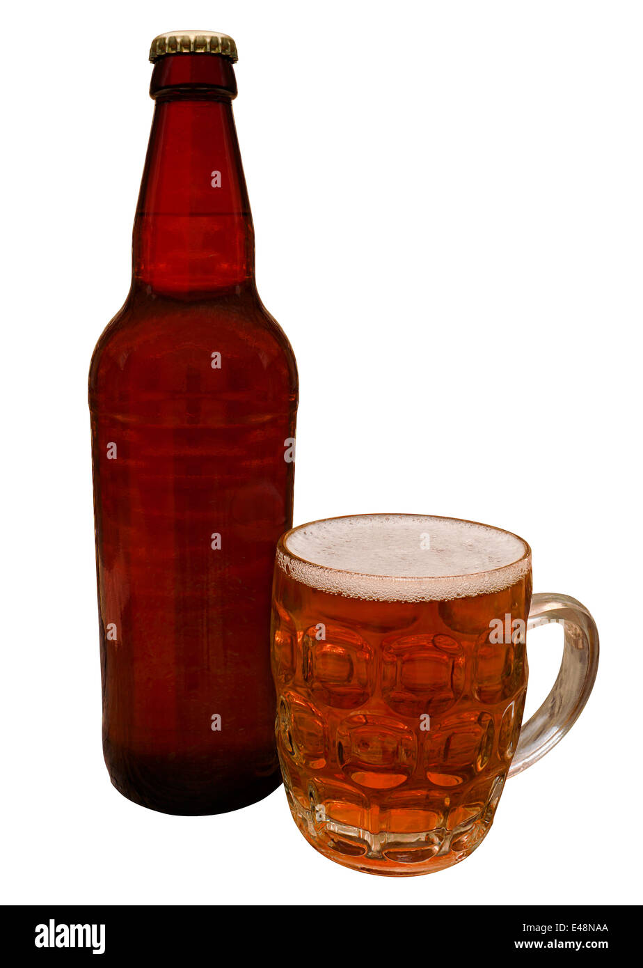 Traditional Craft beer bottle with taster half pint glass containing the real ale ready for drinking in a bar by - Stock Image