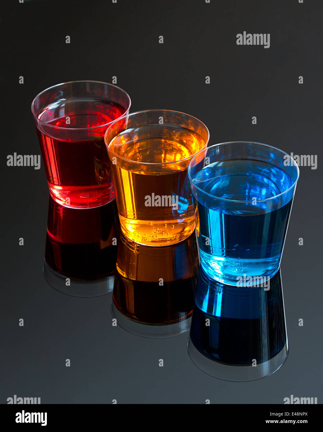 Abstract stylised picture of Three Shooters on a black background great concept for dinks offers at promotional - Stock Image