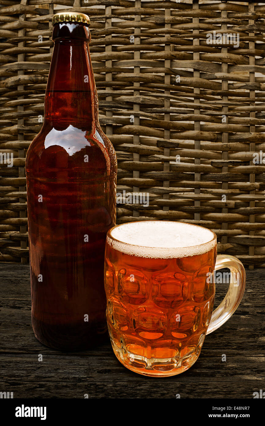 Traditional Craft beer bottle with taster half pint glass of craft beer - Stock Image