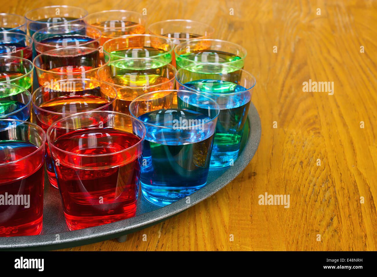 Drinks promotion with various shots on a tray to test as samplers or tasters for merchandising in the drinks industry. - Stock Image