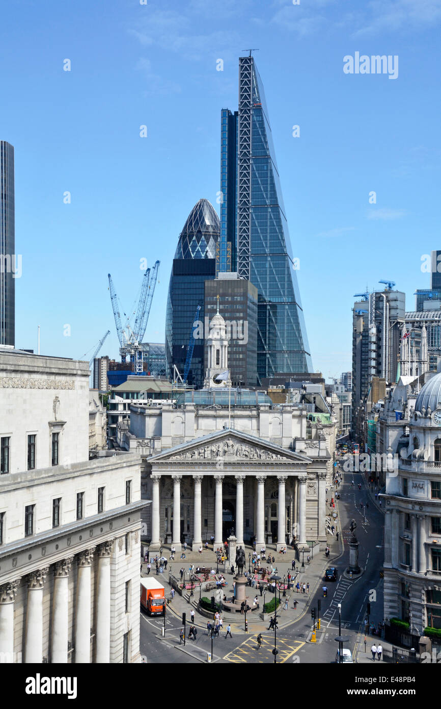 Bank road junction in city of London with Leadenhall landmark Cheese Grater office block towering over Royal Exchange& Stock Photo