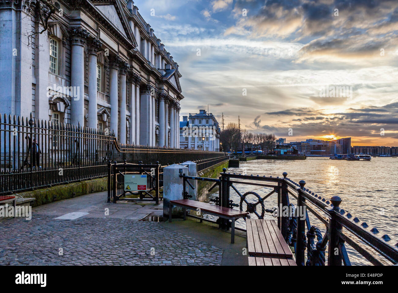 Sunset view of the Old Royal Naval College and river Thames from the Thames path in Greenwich, London, UK Stock Photo