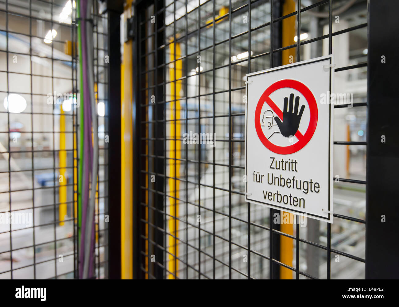 No Entry sign (German translation: 'no entry for unauthorized personnel') at a restricted area / no entry - Stock Image