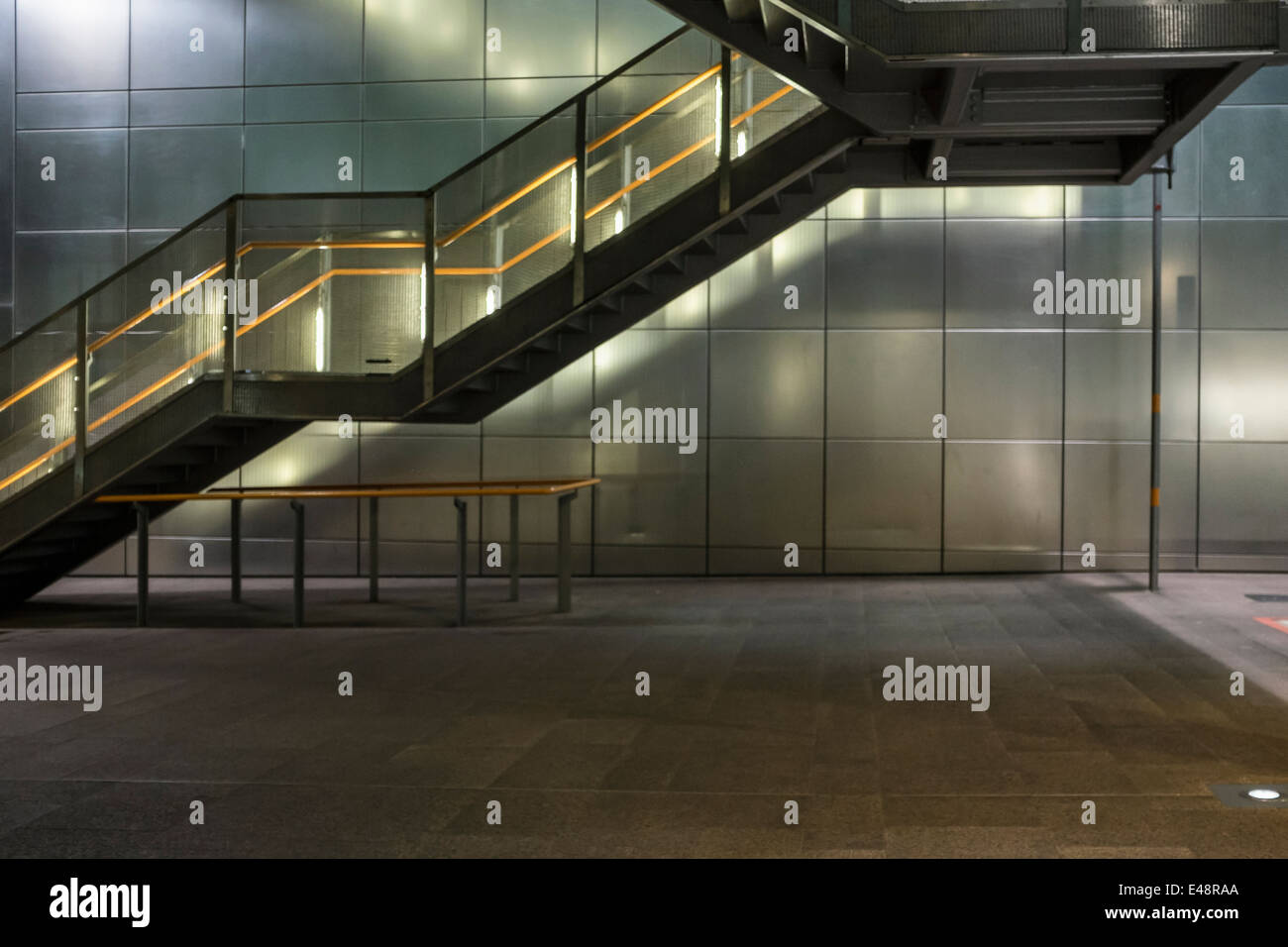 Empty, deserted Heron Quays Docklands Light Railway station stairway and lighting , Canary Wharf, London, UK - Stock Image