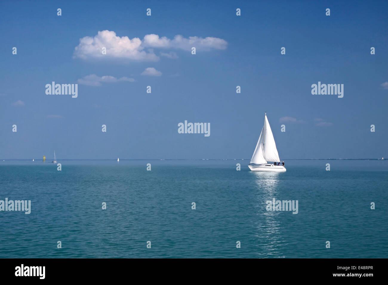 White Sailboat near Balatonfüred at Lake Balaton, Hungary - Stock Image