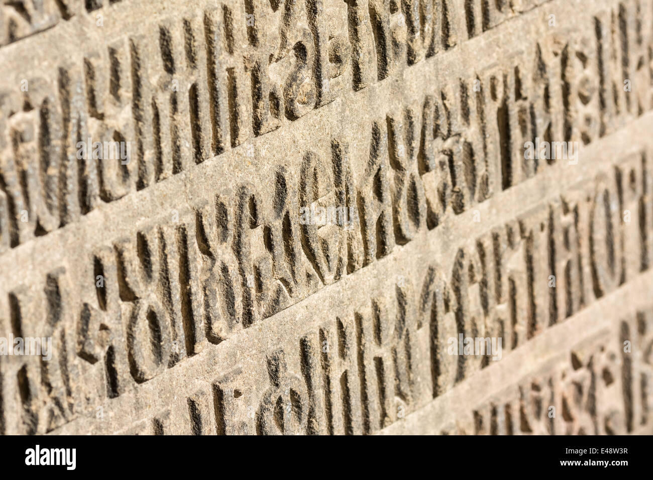 Old Cyrillic Script Letters Carved In Stone - Stock Image