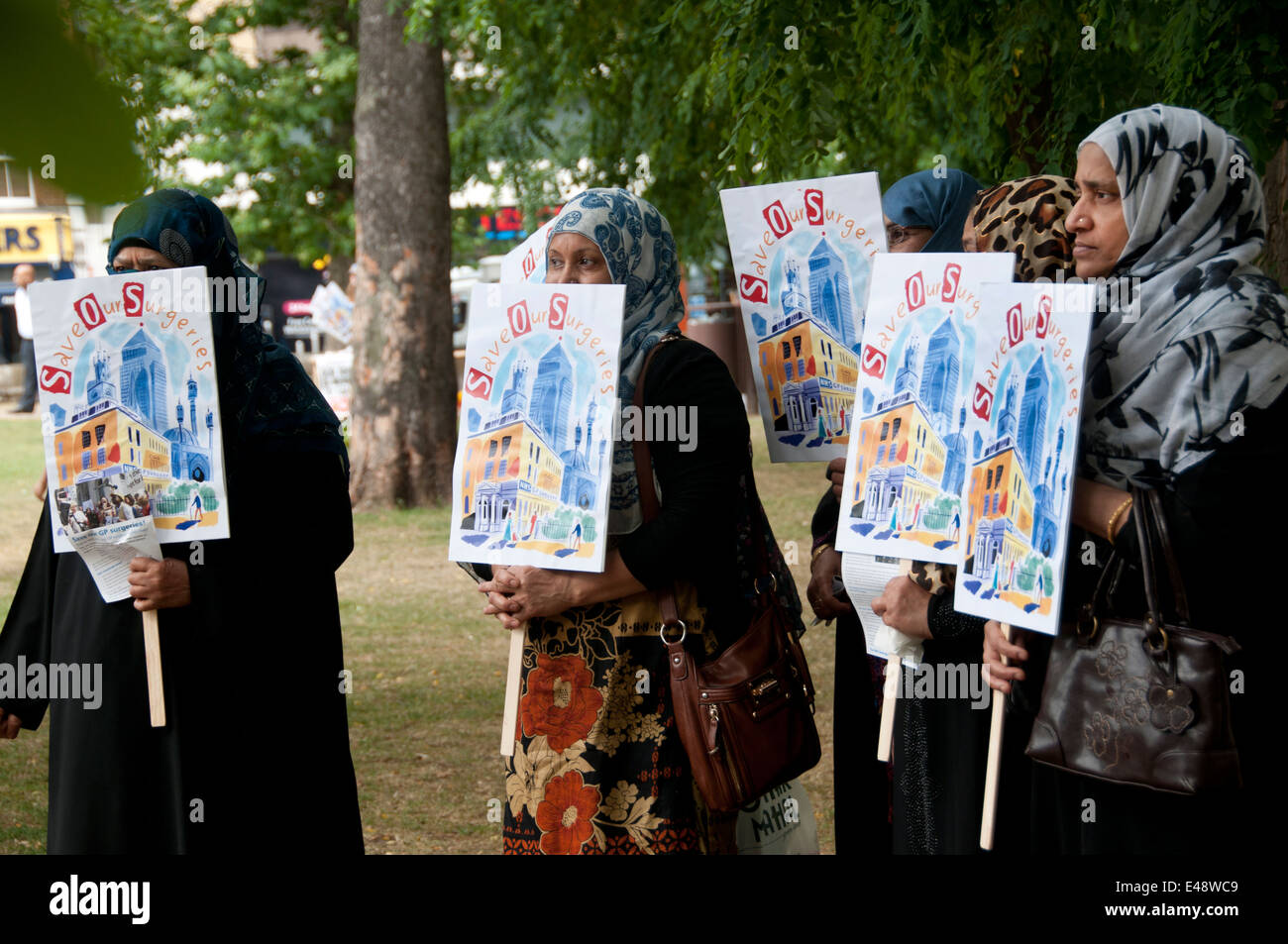 Rally against proposed cuts to National Health Service doctors' surgeries. A group of Bangladeshi women protesters - Stock Image